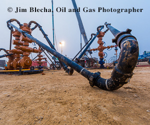 Ad - Jim Blecha, oil and gas photographer. Zipper frac location.