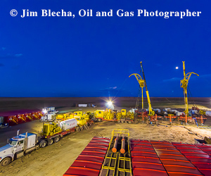 Ad - Jim Blecha, oil and gas photographer. Two coiled tubing rigs completing horizontal Niobrara wells on a five-well pad.